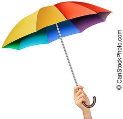 Hand mit einem Regenbogenschirm. Vector.