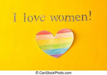 Herz in Form einer LGBT-Flagge auf einem gelben Hintergrund und die Inschrift, die ich liebe Frauen, das Konzept von lgbt, lesbisch und bisexuell.