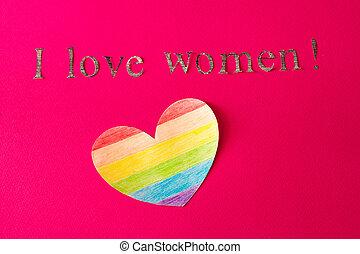 Herz in Form einer LGBT-Flagge auf einem roten Hintergrund und die Inschrift, die ich liebe Frauen, das Konzept von lgbt, lesbisch.