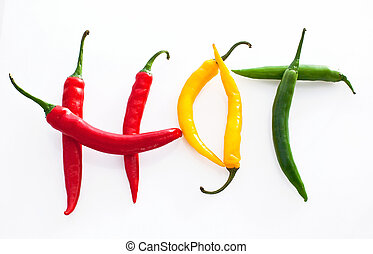 Hot word made from red, yellow and green hot Chili Pepper on white background.