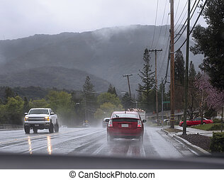 Im Regen fahren.