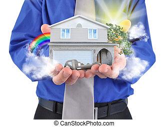 Immobilienhaus in Händen
