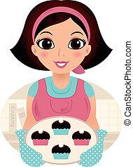 Junge Backfrau mit Keksen