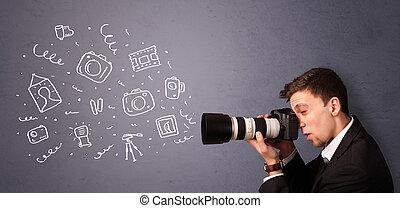Junge Fotografen, die Fotos drehen.