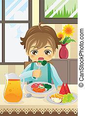 Junge isst Gemüse