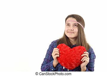 Junges Mädchen mit einem roten Herzen.