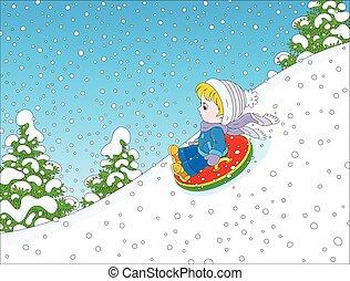 Kind mit einem aufblasbaren Schneeschlauch.