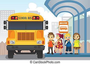 Kinder an der Bushaltestelle.