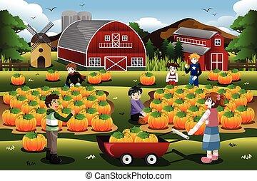 Kinder auf einem Kürbis-Patchtrip im Herbst oder Herbst.