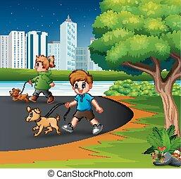 Kinder, die mit ihren Haustieren im Stadtpark spazieren gehen.