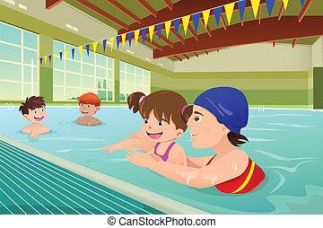 Kinder haben eine Schwimmstunde im Innenpool.
