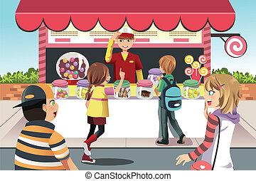 Kinder kaufen Süßigkeiten