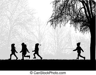 Kinder laufen im Park.