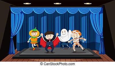 Kinder spielen auf der Bühne.