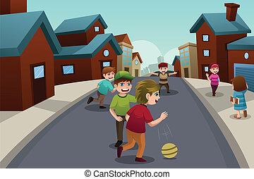 Kinder spielen auf der Straße eines Vorstadtviertels.