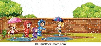 Kinder spielen im Regen.
