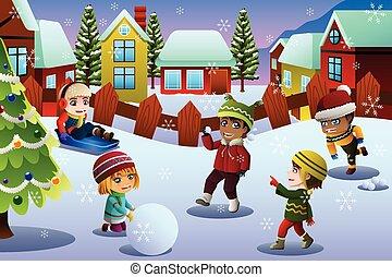 Kinder spielen im Schnee während der Wintersaison.