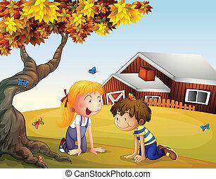 Kinder spielen mit Schmetterlingen in der Nähe eines großen Baumes