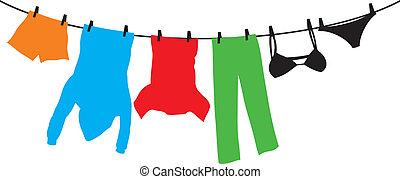 Kleider hängen an einer Wäscheleine