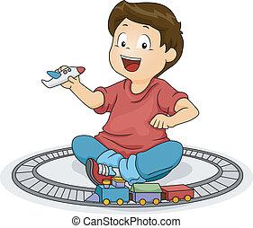 Kleiner Junge, der mit Spielzeug spielt