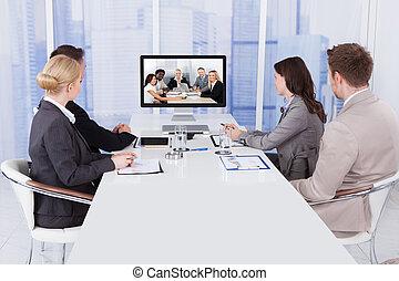 konferenztisch, video, geschäftsmenschen
