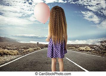 Konzeptuelles Bild eines Mädchens mit einem Ballon.