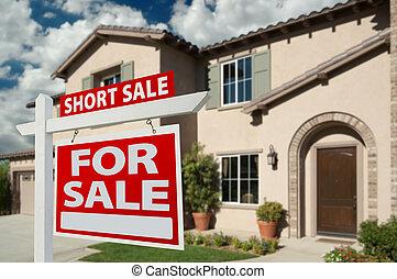 Kurzverkaufs-Immobilienzeichen und Haus