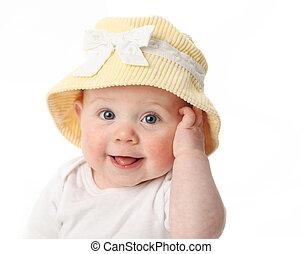Lächelndes Baby mit Hut.