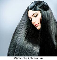 Lange Haare. Wunderschönes Brünette-Mädchen