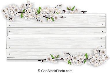 Leeres weißes Holzzeichen mit blühendem Baumzweig