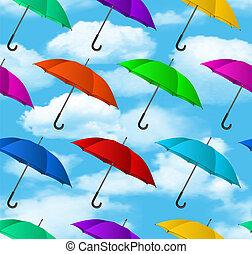 Leichte, bunte Regenschirme im Hintergrund