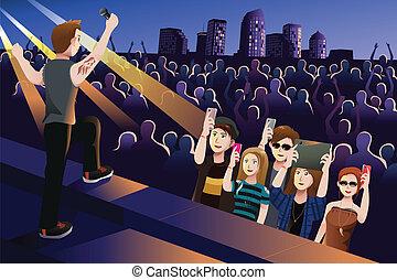 Leute in einem Konzert.
