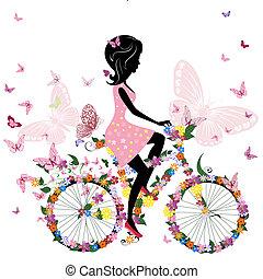 Mädchen auf einem Fahrrad mit romantischen Schmetterlingen