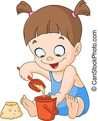 Mädchen, die mit Sand spielt.