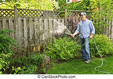 Mann, der Garten