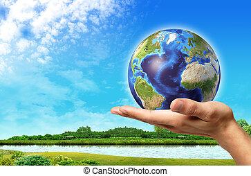 Mann mit Erde auf ihm und einer wunderschönen grünen Landschaft mit Fluss und blauer Himmel im Hintergrund.