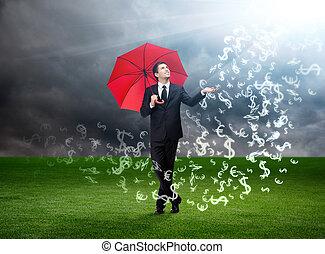 Mann mit rotem Regenschirm und Währungszeichen, die vom Himmel fallen.