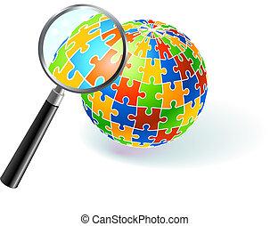 Multifarbiger Globus unter Vergrößerungsglas