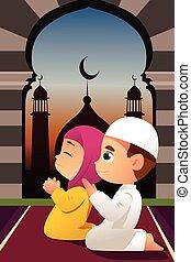 Muslimische Kinder, die in der Moschee beten.