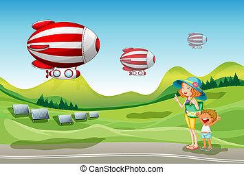 Mutter und Kind sehen ein Raumschiff