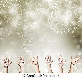 Neujahrskonzept mit bemalten Handfeiern.
