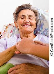 Pfleger mit Händen.