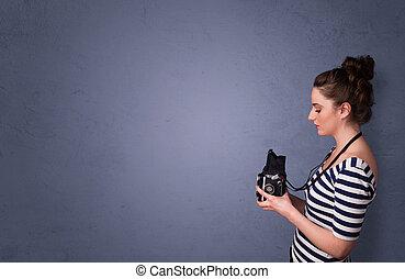 Photographer schießt Bilder mit dem Kopierraumgebiet