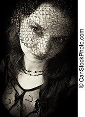Portrait einer jungen Frau im Schleier