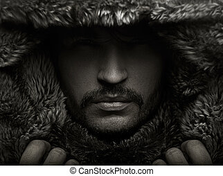 Portrait eines jungen Mannes in Pelzmütze