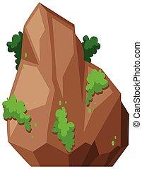 Rock mit grünem Busch.