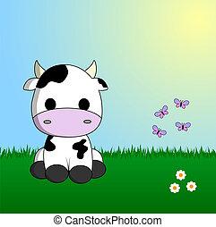 Süße Kuh sitzt im Gras