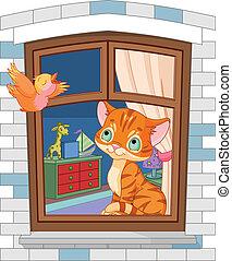 Süßes Kätzchen sitzt am Fenster