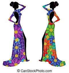 Schöne Damen in langen Kleidern.