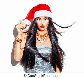 Schöne Weihnachtsmode Model-Mädchen mit langen geraden fliegenden Haaren in rotem Santa-Hut.